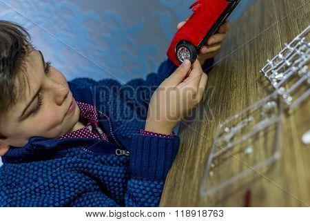Boy Holding Model Car