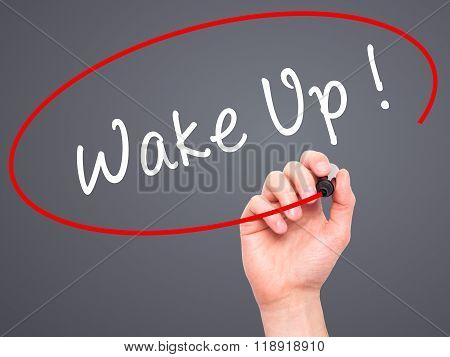 Man Hand Writing Wake Up With Black Marker On Visual Screen