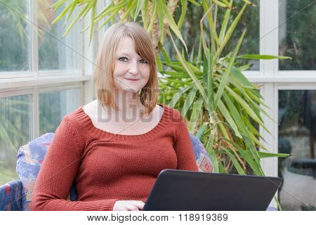 Young Woman With Notebook Is Looking At The Camera