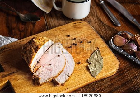 Roast Turkey Meat With Bay Leaf, Pepper And Garlic On Old Cutting Board, Vintage Country Table