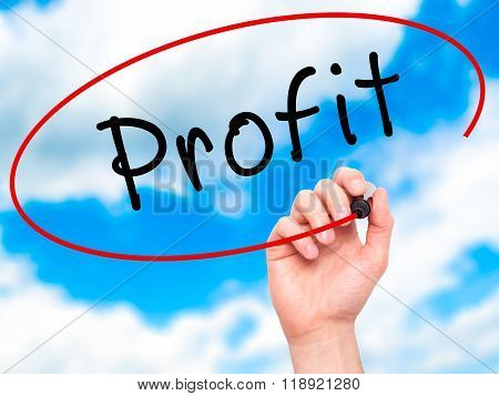 Man Hand Writing Profit With Black Marker On Visual Screen