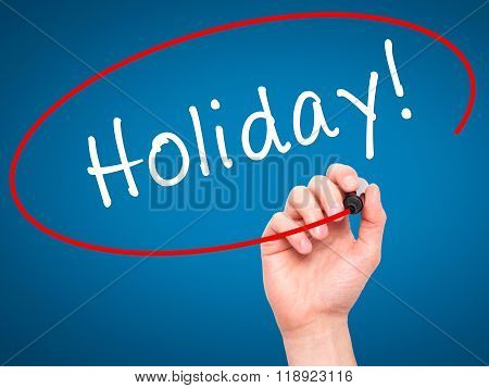 Man Hand Writing Holiday! With Black Marker On Visual Screen