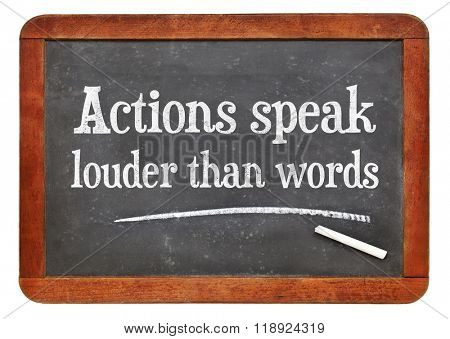 Actions speak louder than words proverb - white chalk text on a vintage slate blackboard