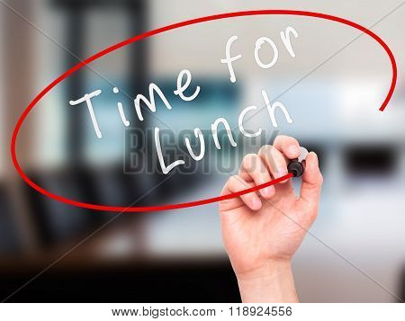 Man Hand Writing Time For Lunch With Marker On Transparent Wipe Board