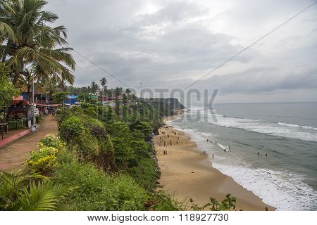 VARKALA, INDIA - OCTOBER 18, 2015: Unidentified people at Varkala beach in India. This beach at Arabian sea is famous for tertiary sedimentary formation cliffs.