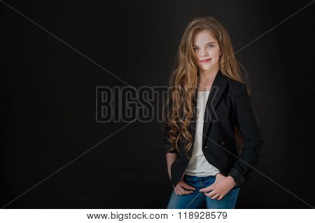 the girl the teenager with long hair on a black background