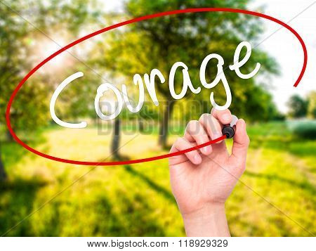 Man Hand Writing Courage With Black Marker On Visual Screen