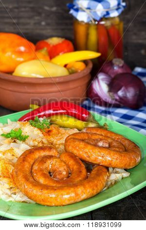 Roasted sausages with sour cabbage