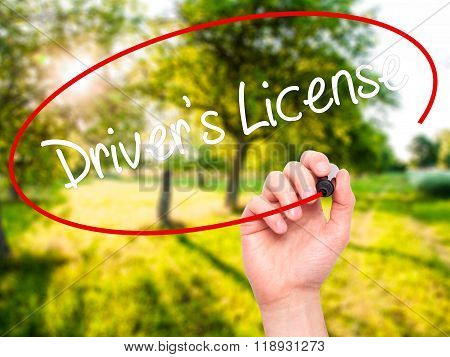 Man Hand Writing Drivers License With Black Marker On Visual Screen