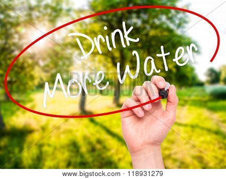 Man Hand Writing Drink More Water With Black Marker On Visual Screen