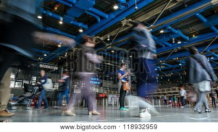 People walking through the Georges Pompidou Centre