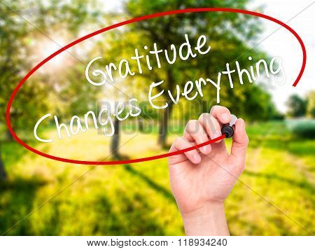 Man Hand Writing Gratitude Changes Everything With Black Marker On Visual Screen
