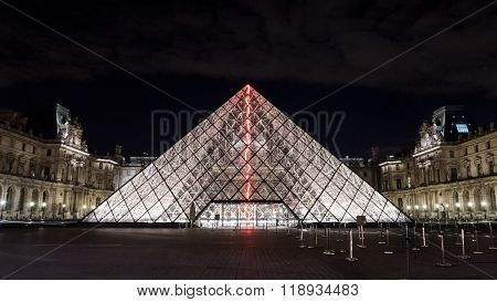 Illuminated glass pyramid at the Louvre, Paris