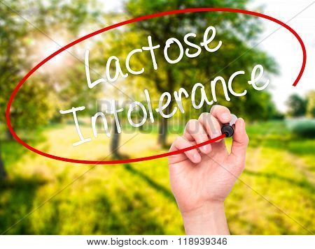 Man Hand Writing Lactose Intolerance With Black Marker On Visual Screen