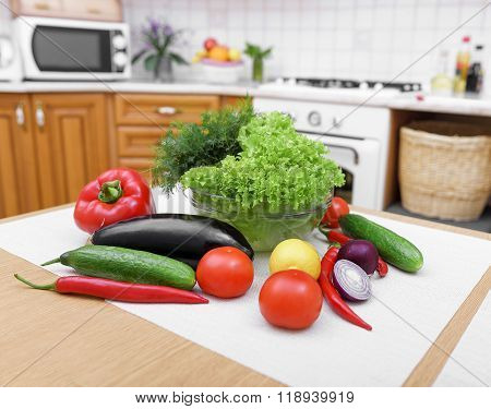 Fresh vegetables on kitchen table.