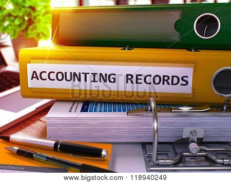 Accounting Records on Yellow Ring Binder. Blurred, Toned Image.
