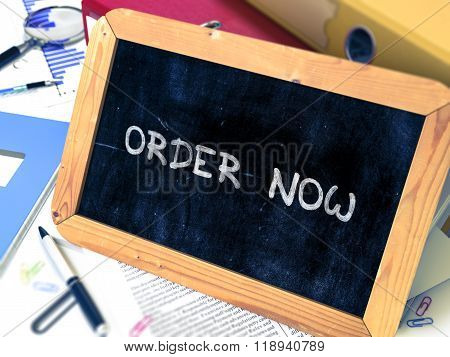 Handwritten Order Now on a Chalkboard.