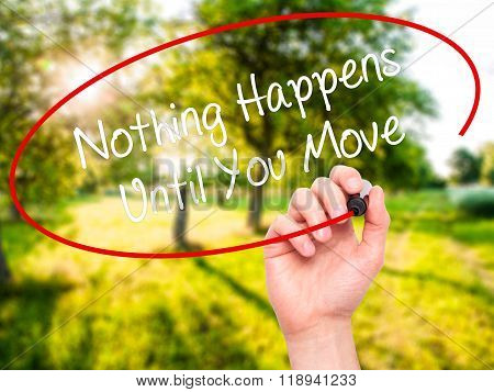 Man Hand Writing Nothing Happens Until You Move With Black Marker On Visual Screen
