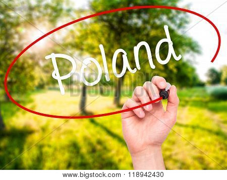 Man Hand Writing Poland  With Black Marker On Visual Screen