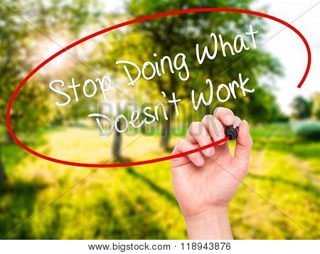 Man Hand Writing Stop Doing What Doesn't Work With Black Marker On Visual Screen