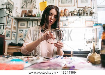 master makes new  Dreamcatcher in art studio.