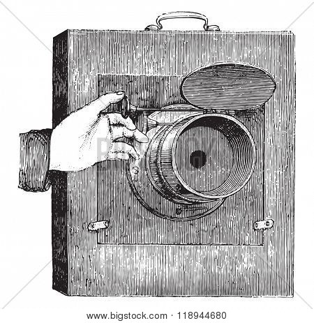 Movable shutter lens for instant photography, vintage engraved illustration. Magasin Pittoresque 1878.