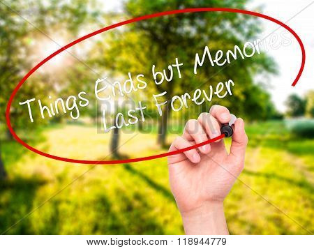 Man Hand Writing Things Ends But Memories Last Forever With Black Marker On Visual Screen