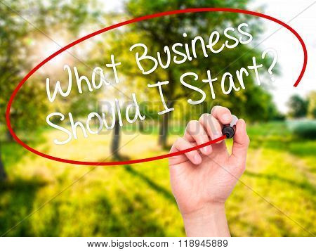 Man Hand Writing What Business Should I Start? With Black Marker On Visual Screen