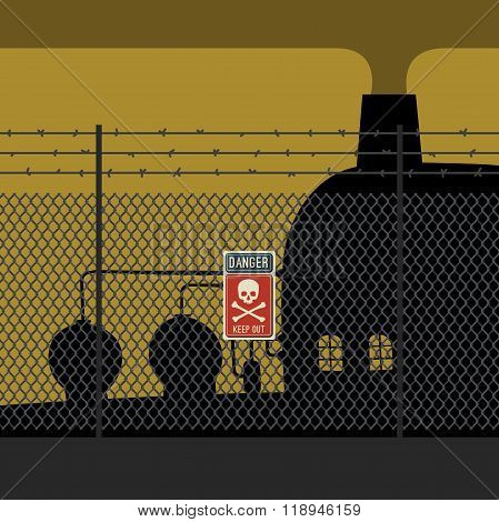 Danger zone with fence and factory.