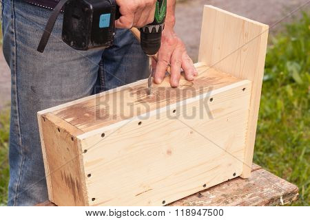 Carpenter Works With Drill, Birdhouse Assembling