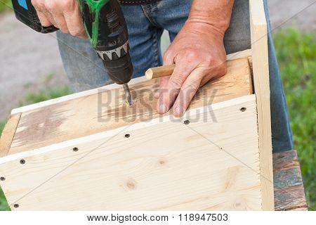 Carpenter Works With Drill, Closeup Photo