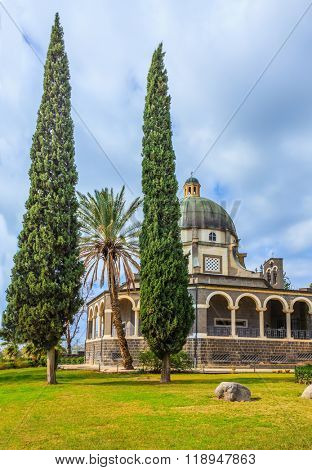 Catholic monastery and a small church Mount of Beatitudes. Beautiful park of cypress and palm trees. Israel, the shores of Lake Kinneret