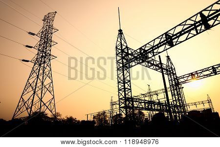 The Silhouette Of High Voltage Substation With An Evening Sky As A Background