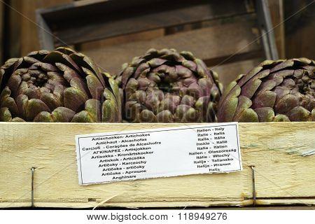 3 Fresh Artichokes Green-purple Flower Head, On Wooden Background