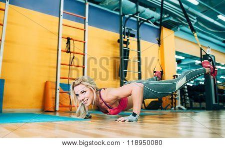 happy athlete doing push-ups on TRX