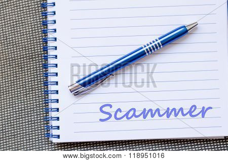 Scammer Write On Notebook