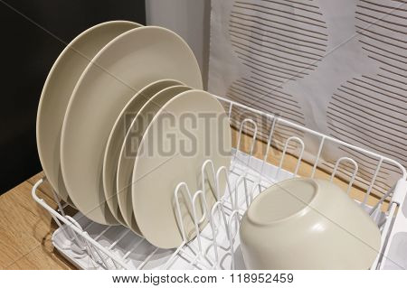 Ceramic Dishes And Bowls In Plate Rack