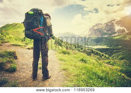 Traveler Man with backpack mountaineering