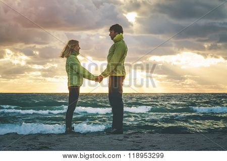 Young Couple Man and Woman holding hands in Love