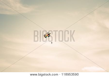 Parachuting extreme Sport with cloudy sky on background