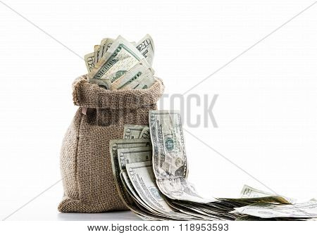 close up view of a bag full of cash money dollars bills in amount