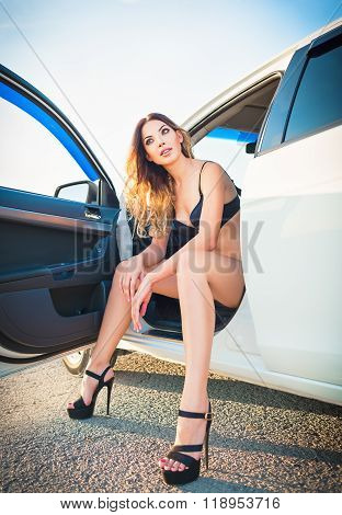 Sexy Young Woman Sitting In Car