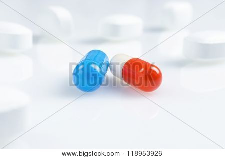 White, blue and red medicine antibiotic pills