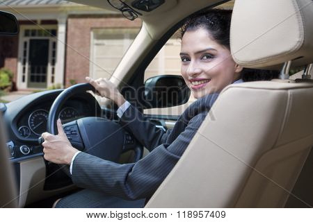 Cheerful Indian Woman Driving New Car