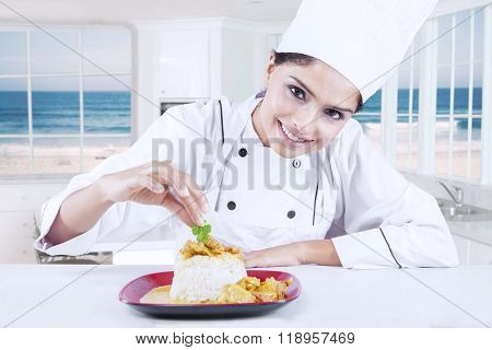 Chef Woman Decorating Delicious Food