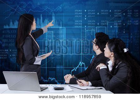 Female Worker Presents Financial Statistics