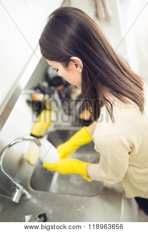 Hand cleaning.Young housewife woman washing dishes in kitchen.Cleaning and washing dishes