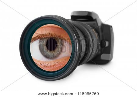 Photo camera and eye in lens isolated on white background