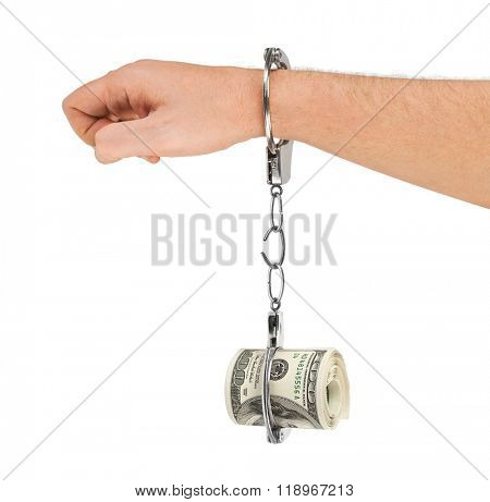 Hand with breaking handcuffs and money isolated on white background