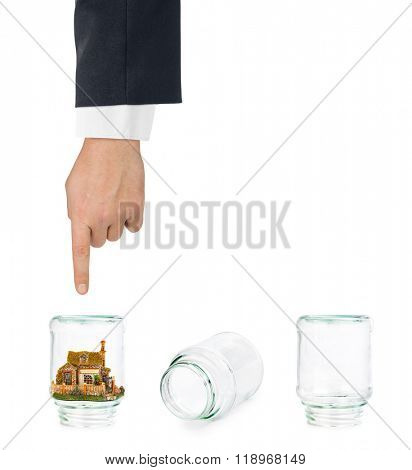 House and shell game with glass jars isolated on white background
